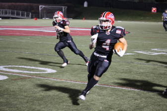 Tommy Root (#4) with an INT return. Credit: Terry Dinan