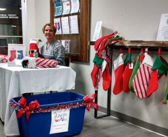 Jeanette Wallace of Hungry Kidzz at Halo Studios. The New Canaan-based nonprofit organization is accepting stockings for its holiday program as well as checks to the support the effort, through Dec. 15. Contributed