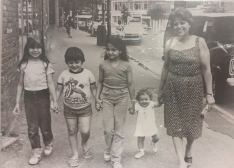 L-R: Mena, Lorenzo, Nancy and Serra Collela on Main Street with their mom, Nancy Collela, in the early 1980s. Contributed