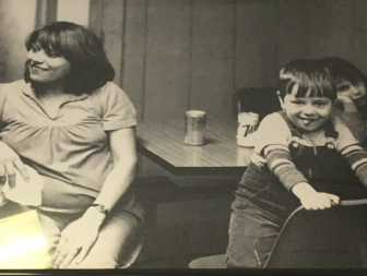 Nancy Colella, pregnant at left, in Joe's Pizza on Forest Street. Lorenzo on the chair in the foreground. Contributed