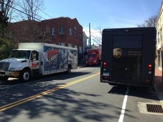 More trucks parked along East Avenue below Main Street.