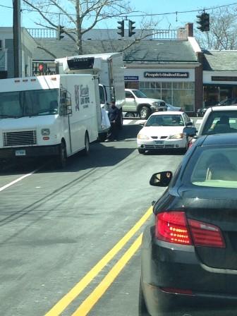 Trucks parked along East Avenue below Main Street.