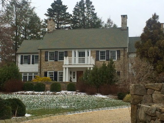 This 1933-built, two-story Colonial at 45 Woods End Road includes 6,989 square feet of living space and sits on 1.62 acres. It sold in January 2016 for $3,520,000. Credit: Michael Dinan