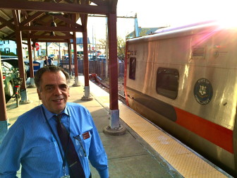 Frank Maltese on the platform at the New Canaan Train Station on March 24, 2016. He's retiring as conductor at the end of May, after nearly 30 years with Metro-North Railroad, including 12 operating on the New Canaan branch line. Credit: Michael Dinan