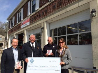 L-R: Leo Karl, president of the New Canaan Community Foundation's Board of Directors, Fire Marshal Fred Baker, Firefighter John Aniello and NCCF President and CEO Cynthia Gorey. Credit: Michael Dinan