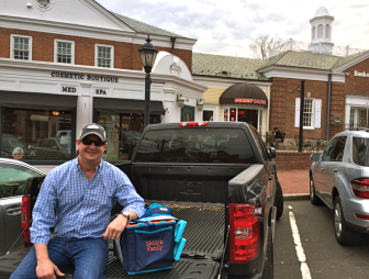 New Canaan's Jeff Mellick with his own Beachmate, a product he conceived and developed with his wife, Beatrice. The 1993 NCHS graduate went live this week with the summer item, which has garnered high praise and promise from industry insiders. Credit: Michael Dinan