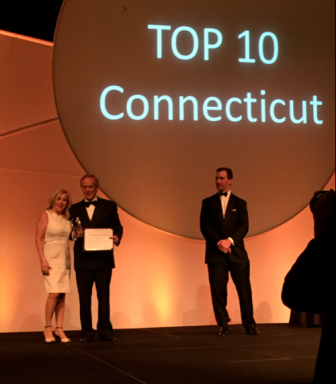 """New Canaanite Denise Gannalo receives a """"Top Producer Award"""" from Bill Raveis at the William Raveis Real Estate Annual Awards Ceremony held at Mohegan Sun on March 30, 2016. Contributed"""