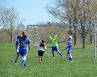 Paige Place waiting for her perfectly placed ball to drop just under the crossbar and out of reach. Contributed