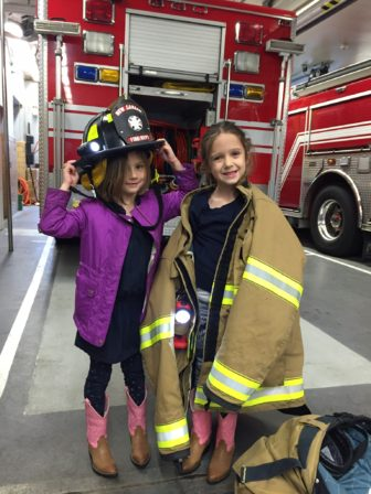 Local husband Stephen Coyle and kids, Charli and Cate, delivered a smoked BBQ dinner to the New Canaan Fire Department while his wife and her joint-venture business partner held the first ever New Canaan Mompreneur Market.