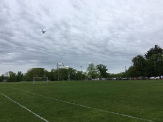 A drone hovers above the soccer fields at Waveny during the May 22, 2016 Caffeine & Carburetors. Credit: Michael Dinan