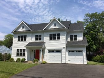 This 2014-built, 6-bedroom Colonial at 75 Parade Hill Road includes 4,846 square feet of living space and sits on .22 acres. It's the site of Syd Greenberg's old house, now demolished. It sold for $1,410,000 in May 2016. Credit: Michael Dinan