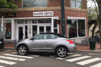 Double-letter and triple-word score for this botched parking job at Main Street and East Avenue. Credit: Michael Dinan