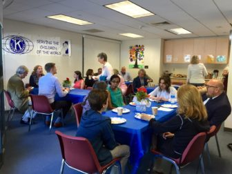 Leaders of local non-profit organizations talk and enjoy coffee and breakfast on Friday morning at the YMCA. Photo Credit: Emilia Savini