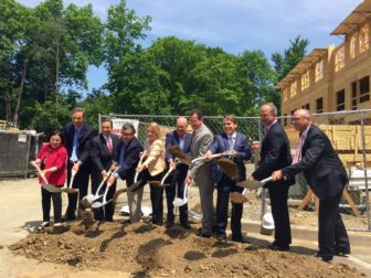 Members of the state and local legislature along with the Board of Commissioners of the Housing Authority of the Town of New Canaan pick up their shovels on the grounds of Phase 1.