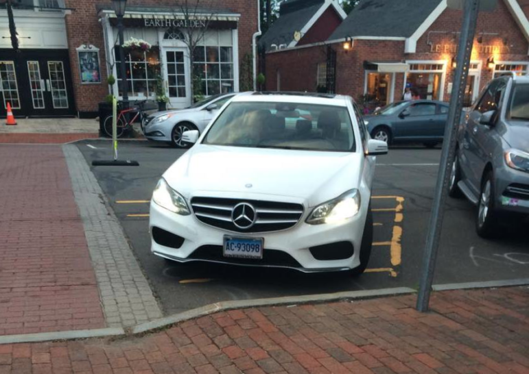 """A botched parking job at the """"50-yard line"""" of Elm Street in New Canaan. MW photo"""
