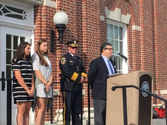 First Selectman Rob Mallozzi addresses those gathered Sept. 9, 2016 at Town Hall for an annual memorial ceremony honoring those lost during the 9/11 terrorist attacks. Credit: Michael Dinan