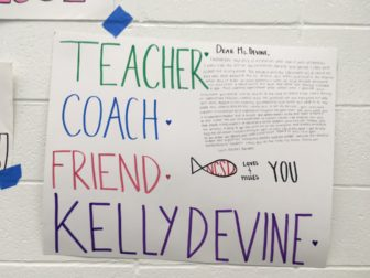 Posters on the walls of the New Canaan YMCA pool during the inaugural 'Kelly Devine Dual' meet between NCHS and Norwalk High School, on Oct. 23, 2016. Credit: Michael Dinan