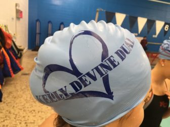 Special swim caps were a feature of the inaugural 'Kelly Devine Dual' meet between NCHS and Norwalk High School, on Oct. 23, 2016 at the New Canaan Y. Credit: Michael Dinan