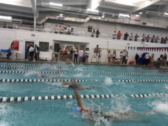 The first leg of the medley relay, the first event at the inaugural 'Kelly Devine Dual' meet between NCHS and Norwalk High School, on Oct. 23, 2016 at the New Canaan Y. Credit: Michael Dinan