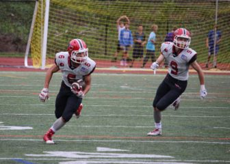Jackson Appelt (#6) with a INT return with Sean Knight (#9) escorting during New Canaan's 35-7 win over Westhill, Oct. 1, 2016. Credit: Terry Dinan
