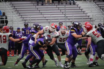 Jack Kircher (#73) with a sack during New Canaan's 35-7 win over Westhill, Oct. 1, 2016. Credit: Terry Dinan