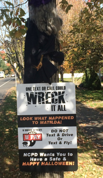 """The crashed witch """"Matilda"""" is back out front of NCPD as a reminder not to text and drive."""