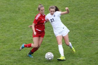 Katherine Reiss battles for the ball against Staples in New Canaan girls soccer's CIAC Class LL first round game on Nov. 9, 2016. Credit: Samantha Loomis