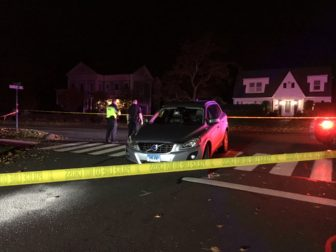 An SUV remained in the roadway on Monday night while accident reconstruction experts arrived at Harrison and South Avenues, where two pedestrians had been struck by the vehicle. Credit: Michael Dinan