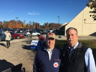 First Selectman Rob Mallozzi stands with Town Councilman Ken Campbell at New Canaan High School on Nov. 8, 2016, Election Day. Credit: Michael Dinan