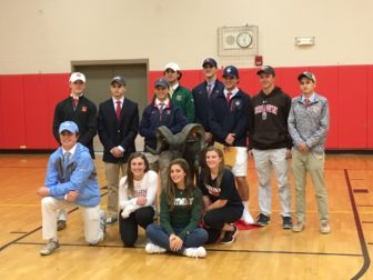 These thirteen NCHS seniors signed early letters of intent to play sports in college, on Nov. 9, 2016. Credit: Michael Dinan