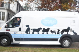 Marie Maguire pulling her InstaGroom mobile dog grooming truck out of her driveway in Stamford. Credit: Keelin Daly