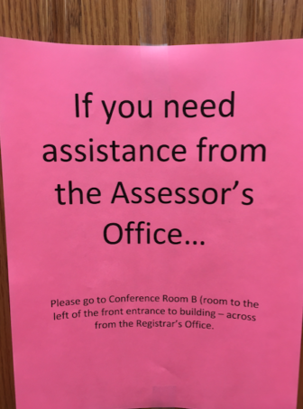 This sign greets visitors to the Assessor's Office at Town Hall. Its located just around the corner, temporarily, while a possible mold problem is worked out. Credit: Michael Dinan